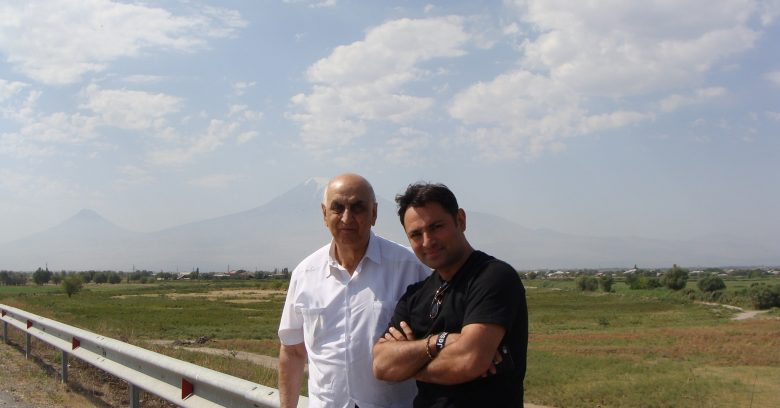 Pastor Joseph Hovsepian and Hakob Ean in front of Great Ararat (with snow at the top) and Little Ararat (to the left).